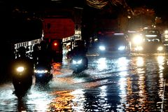 Water flood car. Car and water flood on the road of bangkok thailand royalty free stock photo