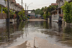 Water flood village. Bangkok, Thailand - May 15, 2016 : Water flood village in Don Mueang district. Problem with the drainage system Stock Image