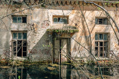 Water-flooded abandoned house. Abandoned building exterior, Water-flooded house stock photos