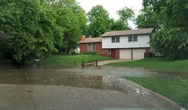Water Flooding in Front of a House stock photography