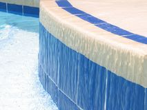Water Flow. Ing over tiles in a swimming pool royalty free stock photos