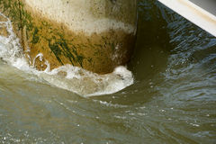 Water flow around concrete wall. Water flow around concrete round wall corner in river Stock Photography