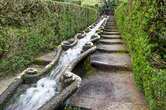 Water flow long fountain. Royal gardens Royalty Free Stock Image