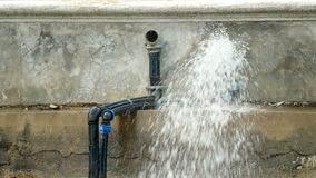 Water flow out from the tube stock video footage