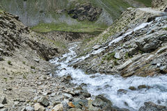 Water flow over mountain road. Water flow over Himalayan mountain road Stock Photo