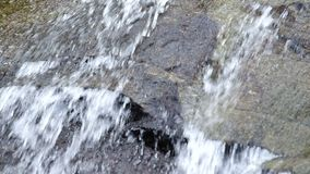 Water flow over the rock stock video footage