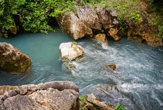 Water flow Pass the stone. Small water flow pass islet in canal Royalty Free Stock Photo