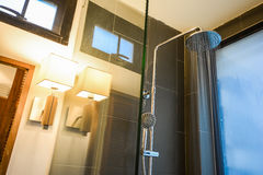 Water flow from rain shower in bathroom Royalty Free Stock Image