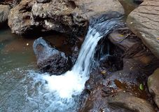 Water flow on rocks by the fall. As a background image for design use or wallpaper stock photo