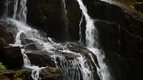 Water flow on rocks of Skakalo waterfall. Beautiful summer scenery of Carpathian nature. closeup detail view with polarizing effect stock video