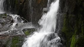 Water flow on rocks of Skakalo waterfall stock video
