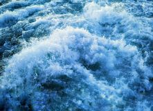 Water flow waves blue. Sea ​​waves blue foam nature royalty free stock photos