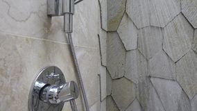 Water flow in the shower head. The bathroom with a shower and means for washing of hair and a body.  stock video