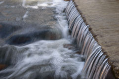 Water flow on step Stock Photos