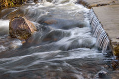 Water flow on step Royalty Free Stock Photos