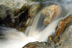 Water flow among stones Royalty Free Stock Image