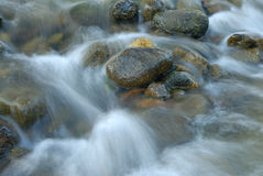 Water flow among stones Stock Photo