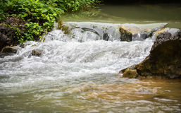 Water flow stream. Closeup water flow on the rock in stream Royalty Free Stock Photography