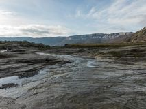 WATER FLOW FROM THE THAW. RUN THROUGH THE SLATE ROCKS stock image
