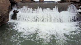 Water flow under bridge. Flight on quadcopter. Top view stock video