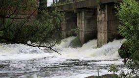 Water flow under the bridge stock footage