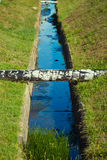 Water flowing. In the ditch Royalty Free Stock Photo