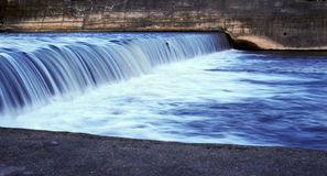 Water flowing. Clear blue water flowing. Cold stream in motion blur Stock Photo
