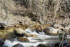 Water flowing in the brook royalty free stock image