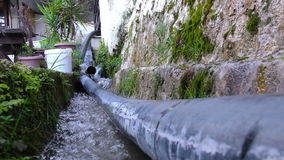 Water is Flowing in Channel and Plastic Tube stock footage