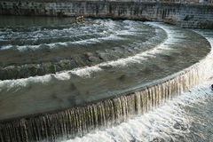 Water flowing in city Stock Photography