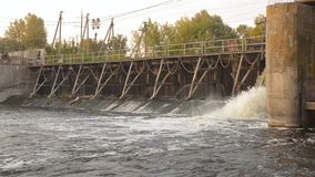 Water flowing from the dam. Closeup shot stock footage
