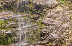 Water flowing down rocky ledge Royalty Free Stock Photo