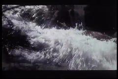 Water flowing down waterfalls in slow motion stock footage