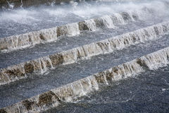 Water flowing downwards. Along steps Stock Photo