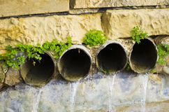 Water flowing. From four outlets leading to a lake Stock Photo
