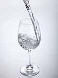 Water flowing into glass Royalty Free Stock Photos