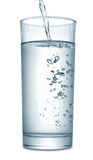 Water flowing in glass Stock Images