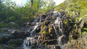 Water flowing from the hill like many waterfalls royalty free stock photos