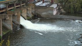 Water flowing on hydroelectric power station 4k. Water flowing on hydroelectric power station dam 4k stock video