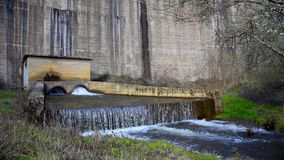 Water flowing on hydroelectric station dam stock video footage