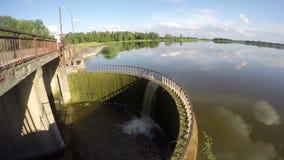 Water flowing through lake dam, time lapse 4K. Lake dam construction in Lithuania, time lapse 4K stock footage