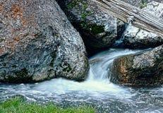 Water Flowing Through Large Rocks HDR. Water flows between large rocks in HDR stock photos