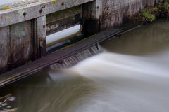 Water flowing through a lock stock image