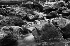 Water flowing in mountains Stock Images