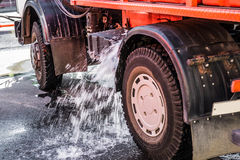 Water flowing out of a water tank of a machine. Water flowing out of a water tank of a street cleansing machine. There is a screw loose somewhere Royalty Free Stock Photo