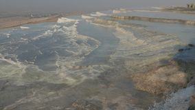 Water flowing over calcium travertines in Pamukkale, Turkey. 4k. Natural sightseeing of flowing mineral water over white limestone terraces in Pamukkale, Turkey stock footage