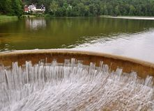 Water flowing over the dam Stock Photography