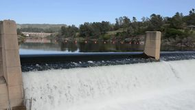 Water Flowing over a Dam stock video footage