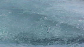 Water flowing over an ice surface in the Katun River in the spring. Water flowing over an ice surface in the Katun River in  spring stock video footage