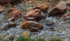 Water Flowing Over Large Boulders Royalty Free Stock Photos